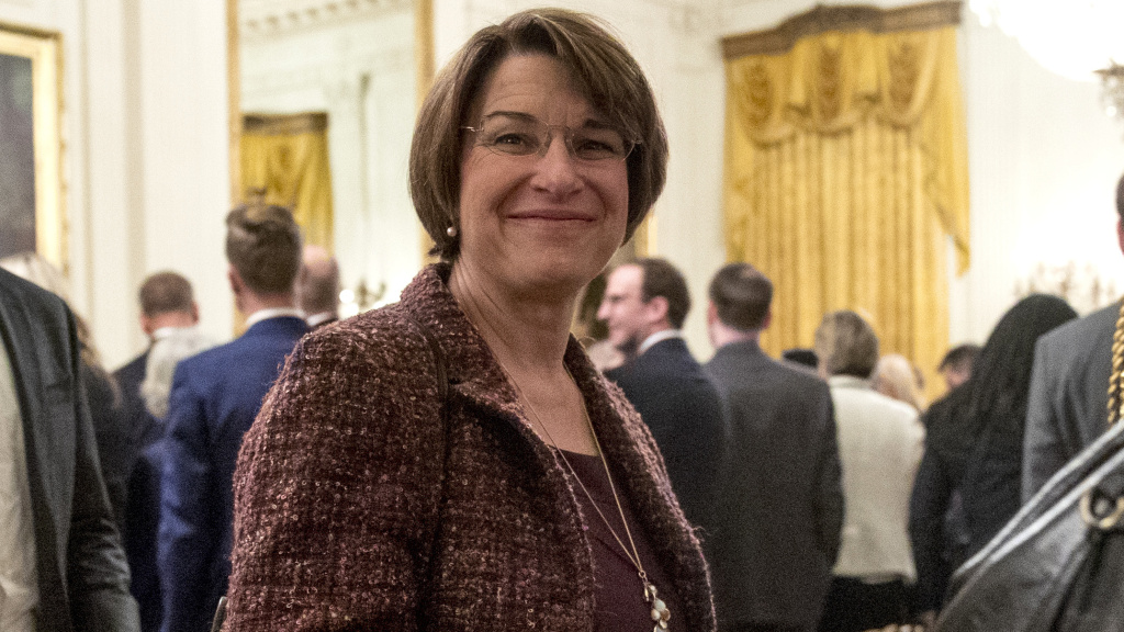 Sen. Amy Klobuchar, D-Minn., departs following a Medal of Freedom ceremony in the East Room of the White House.