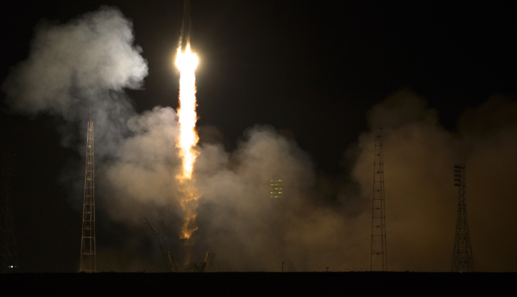 The Soyuz-FG rocket booster with Soyuz TMA-12M space ship carrying a new crew to the International Space Station (ISS) blasts off at the Russian leased Baikonur cosmodrome, Kazakhstan, Wednesday, March 26, 2014. The Russian rocket carries U.S. astronaut Steven Swanson, Russian cosmonauts Alexander Skvortsov and Oleg Artemyev.