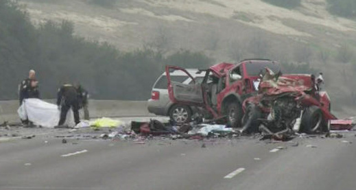 Investigators at the scene of a wrong-way wreck on the 60 Freeway that killed six people on February  9, 2014.