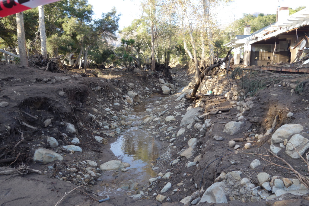 Montecito Creek just north of East Valley Road (aka Route 192) overflowed its banks. The mud rose so high it left a mark five feet high on the white house on the creek's edge. The debris tore through that home's garage and some front rooms. Downstream, the same debris flow ruined several more nearby homes.