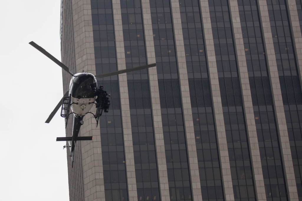 An LAPD helicopter flys low over Figueroa Street during a counter-terrorism demonstration in Downtown.