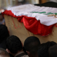 Iraqi Shiite mourners carry the coffin of a soldier killed in clashes with anti-government fighters in Fallujah earlier this month. The government faces a months-long crisis in Anbar province, where it has lost the city of Fallujah as well as shifting par