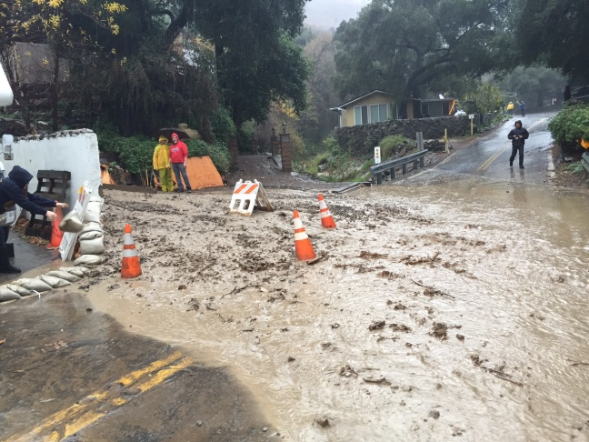 Orange County Public Works crews removed tons of mud from Silverado Canyon Road on Tuesday, Jan. 5, 2016. The residential area is below a recent wildfire that left the hillside vulnerable to mudslides. About 50 homes were under voluntary evacuation since Tuesday morning, and that request to stay away continued in the afternoon.