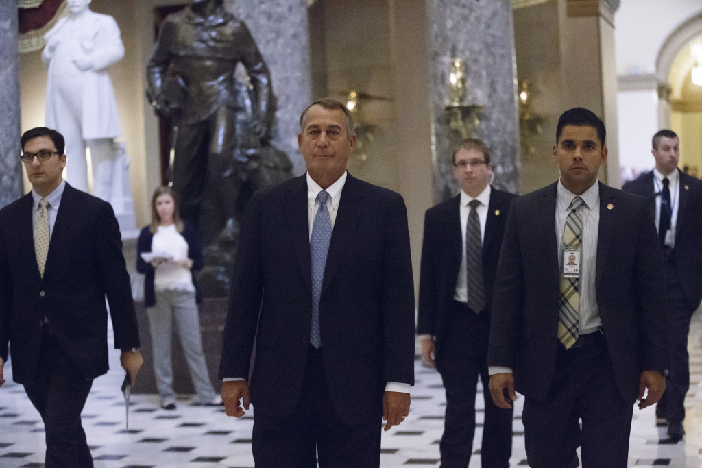 House Speaker John Boehner of Ohio walks from the House chamber on Capitol Hill in Washington, Wednesday, Jan. 14, 2015, as lawmakers vote to fund the Department of Homeland Security but will curb President Barack Obama's executive actions on immigration.