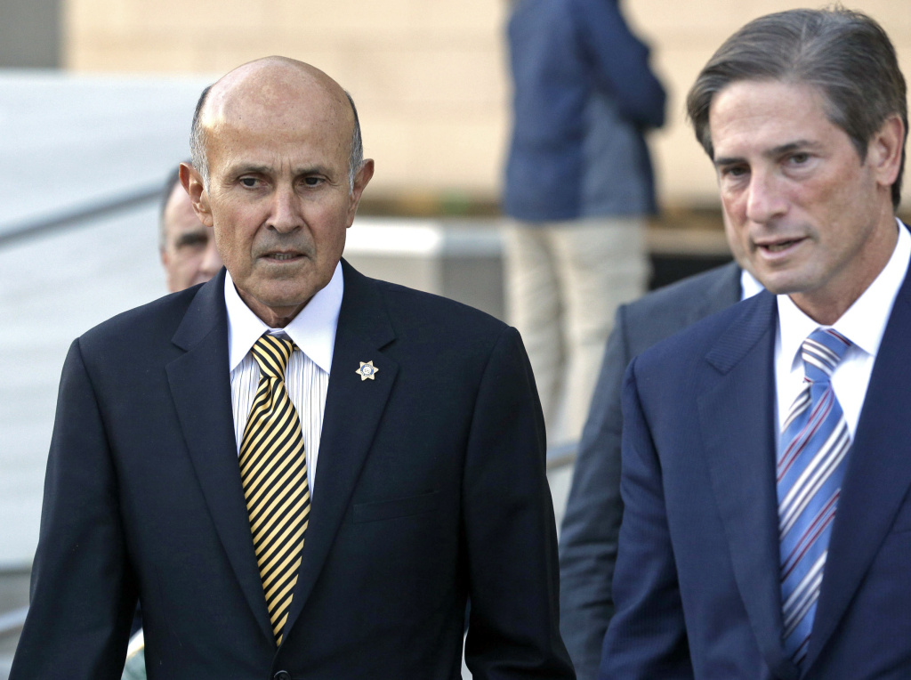 Former Los Angeles County Sheriff Lee Baca, left, and his attorney Nathan Hochman leave federal court in Los Angeles, Monday, Dec. 19, 2016, after the prosecution and defense presented their closing arguments and the case went to the jury. The longtime lawman is charged with conspiracy and obstruction of justice for acts his subordinates carried out in August and September 2011, when his deputies discovered an inmate with a smuggled cellphone was an FBI informant using the device to document abuses.