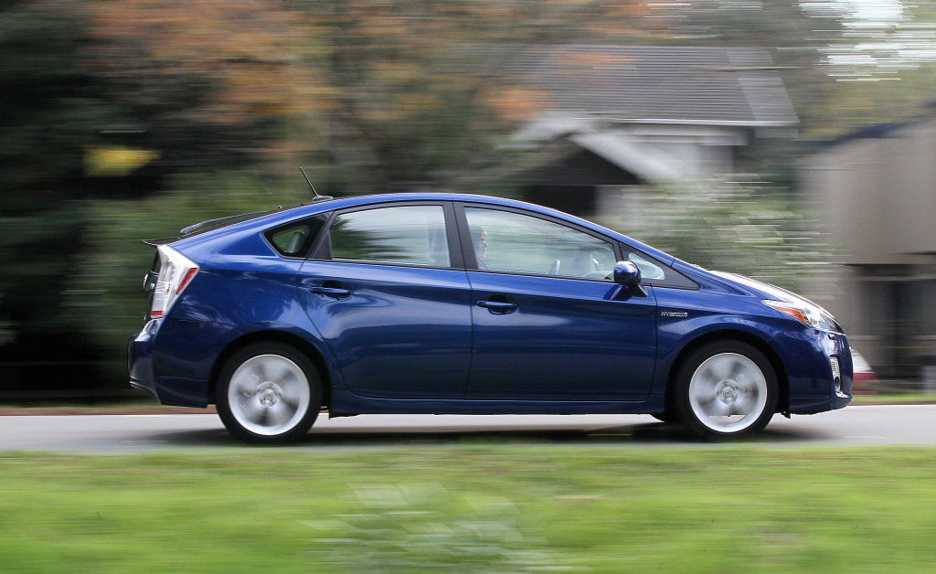 A Toyota Prius Drives In Residential Neighborhood San Anselmo California 2010