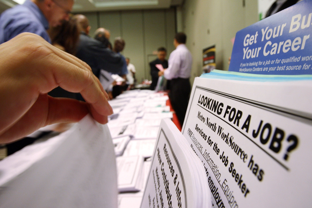 Job seekers look over job opening fliers at the WorkSource exhibit, a collaborative effort by governmental agencies to offer jobs and job training resources at the Greater Los Angeles Career Expo at the Pasadena Convention Center on May 14, 2009 in Pasadena, California.