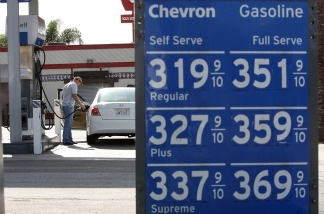 A man puts gas in his car at a Chevron station on January 8, 2010 in Pasadena, California. The price of crude is up 12 percent in the past month to about $82.88 a barrel. The national average price of gasoline is a dollar more than last year, rising above $2.72 per gallon.