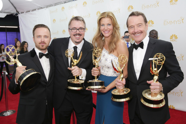Aaron Paul and, from left, Vince Gilligan, Anna Gunn and Bryan Cranston pose with their awards for outstanding drama series for their work on