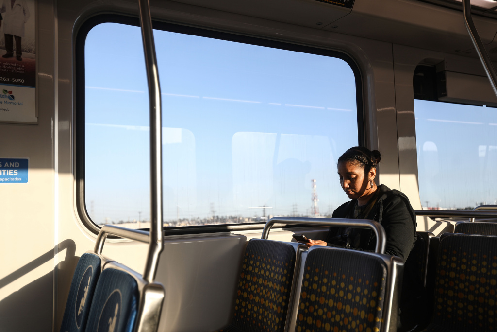 A woman rides a Metro train on March 28, 2018 in Los Angeles, California.
