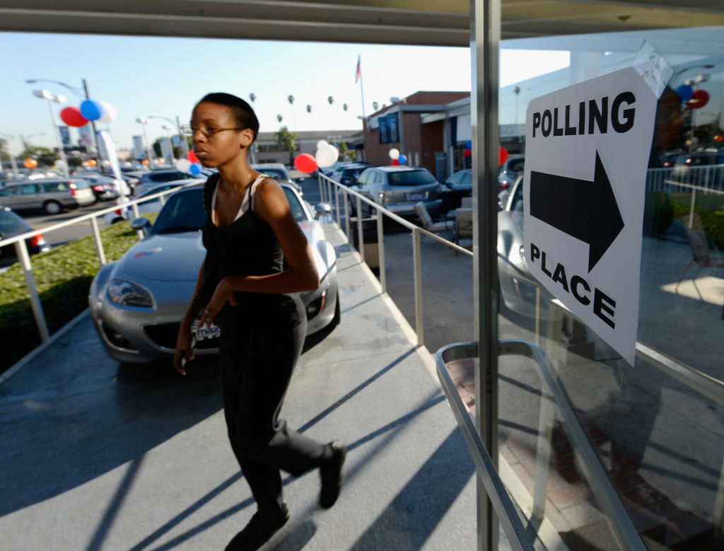 Tricia Barney arrives to vote in the US presidential election at the polling place of Star Mazda car dealership on November 6, 2012 in Glendale, California. Californians will cast ballots in dozens of tight races including Gov. Jerry Brown's tax plan, abolishing the death penalty, easing the state's strict 'three strikes' sentencing law and also in the Presidential race between Democratic President Barack Obama and Republican candidate Mitt Romney.