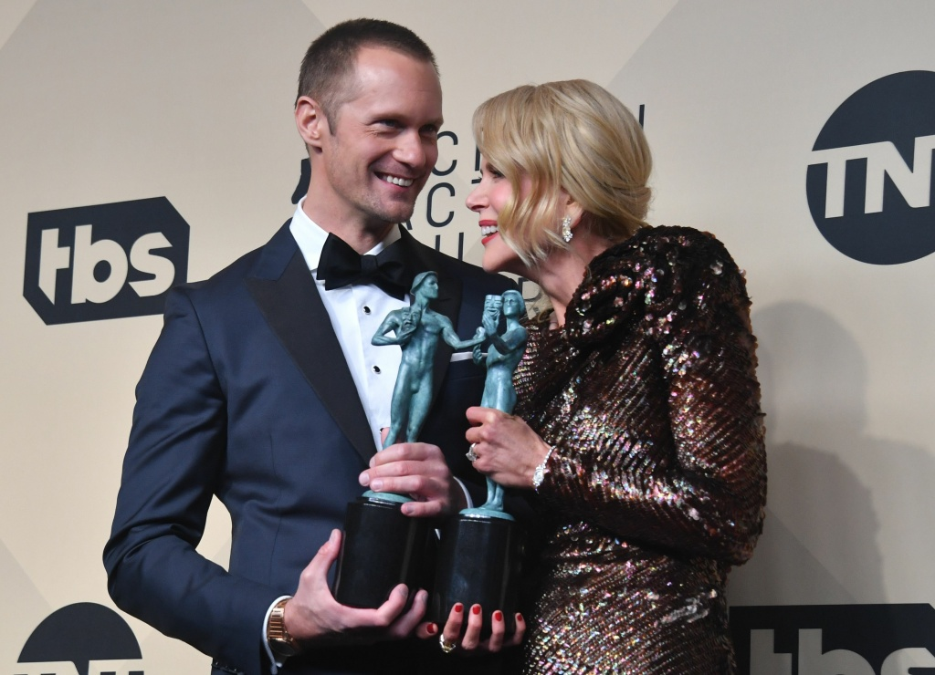 Alexander Skarsgård and Nicole Kidman pose with their trophy for Best Actor/Actress in a Miniseries or Movie in the press room at the 24th Annual Screen Actors Guild Awards at the Shrine Exposition Center on January 21, 2018 in Los Angeles, California.