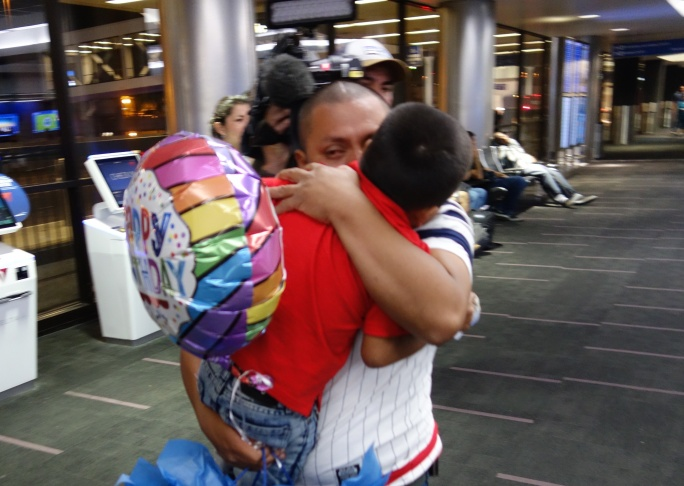 Unauthorized Guatemalan immigrant Hermelindo Che Coc hugs his son Jefferson, 6, after the pair were reunited at LAX following a 48-day separation forced by a change in federal immigration policy.