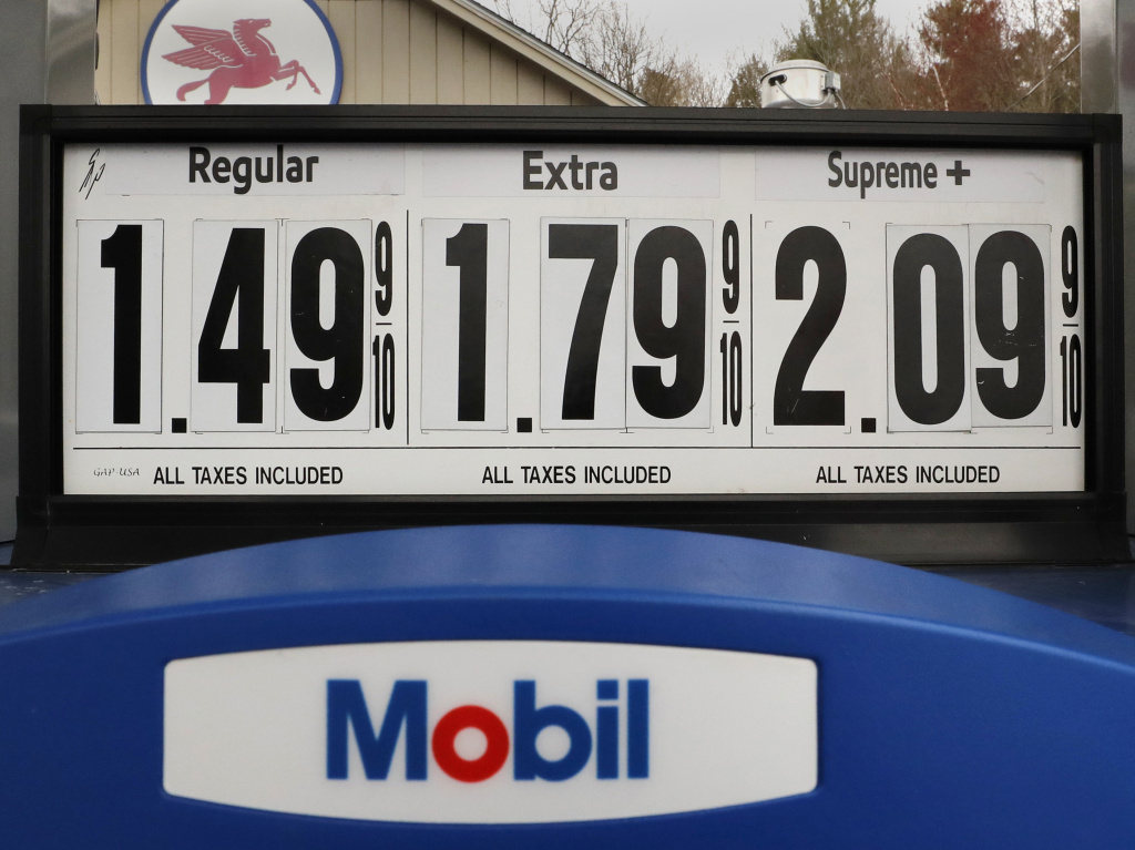 Gasoline prices are posted at a Mobil gas station in Candia, N.H., on April 30. The coronavirus pandemic has renewed a critical debate about just when global oil demand will peak.