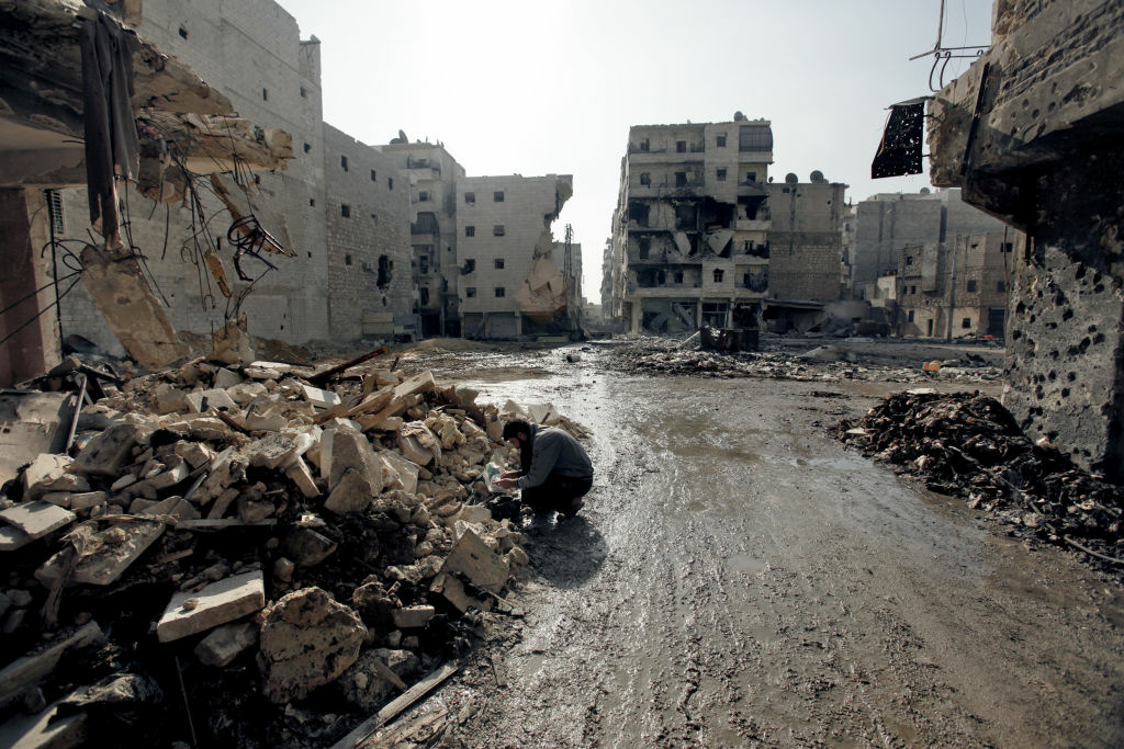 A man is seen in the al-Amirya neighborhood of the city of Aleppo on December 2, 2012. Syrian artillery and aircraft battered rebel positions in and around Damascus in an operation to secure the capital, as Russia and Turkey prepared for talks on their differences over the conflict.