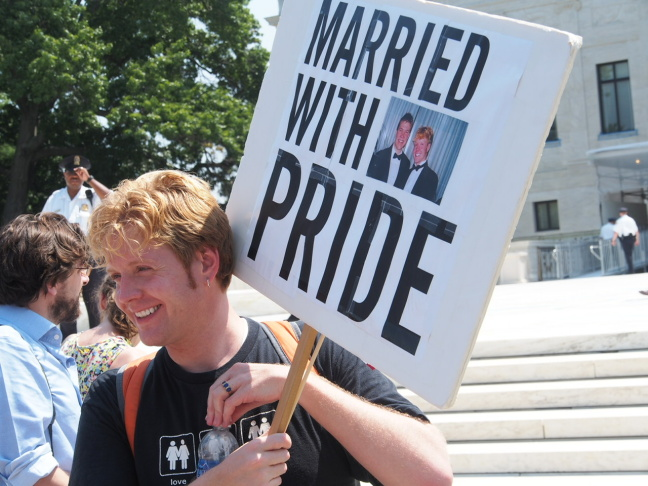 Brandon Brown, left, and Colby Melvin of West Hollywood attend a viewing party at the Abbey on Wednesday, after the Supreme Court decisions on Proposition 8 and the Defense of Marriage Act. Brown and Melvin have been engaged for four months.
