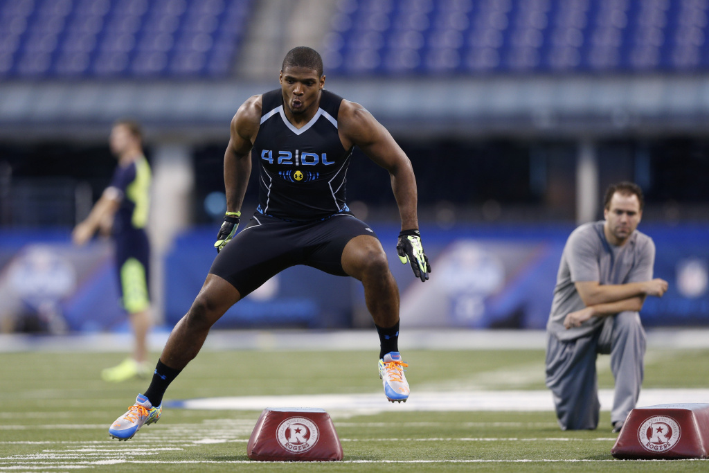 Former Missouri defensive lineman Michael Sam takes part in position drills during the 2014 NFL Combine at Lucas Oil Stadium on February 24, 2014 in Indianapolis, Indiana.