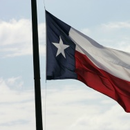 The Texas flag flies at Texas Memorial Stadium in Austin.