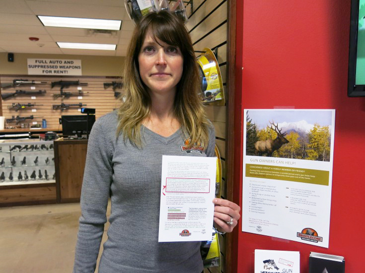 Jacquelyn Clark, co-owner of Bristlecone Shooting, Training and Retail Center in Lakewood, Colo., holds a list of gun safety rules. One recommendation: Consider