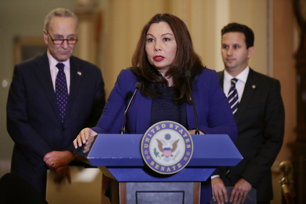 Sen. Tammy Duckworth (D-IL) (C) talks to reporters with Senate Minority Leader Charles Schumer (D-NY) (L) and Sen. Brian Schatz (D-HI) following the weekly Democratic policy luncheon at the U.S. Capitol November 7, 2017 in Washington, DC.