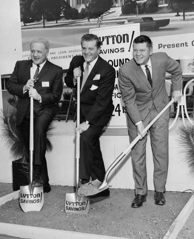 "Original caption for this 1965 photo: ""Dig That Money - In a most appropriate gesture, one of the first men to turn a shovel of dirt on the site of the new Lytton Savings and Loan Association yesterday at ground-breaking ceremonies in Canoga Park was Bart Lytton, left, board chairman of the association. Helping Lytton were Francis Lederer, center, honorary mayor of Canoga Park, and Warren M. Dorn, Los Angeles County Supervisor."""