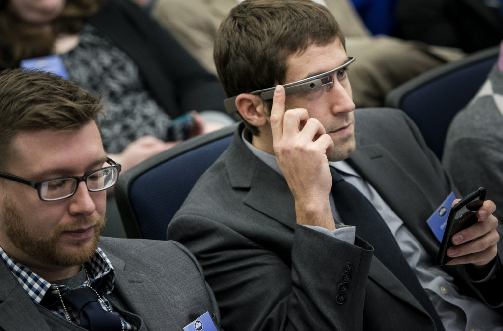 An attendee uses a Google Glass during the White House Youth Summit at the White House December 4, 2013 in Washington, DC.