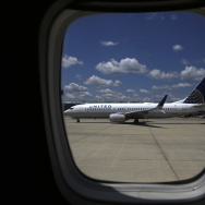 A United Airlines jet taxis to a gate at O'Hare International Airport in Chicago in June.