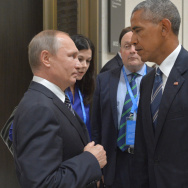 Russian President Vladimir Putin, left, speaks with then- U.S. President Barack Obama in Hangzhou in eastern China's Zhejiang province on Sept. 5, 2016, in the midst of last year's presidential race.