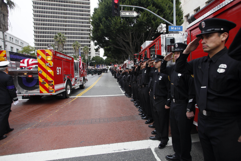 A fire truck carrying the remains of fallen Los Angeles Firefighter Glenn Allen passes in review outside the Cathedral of Our Lady of the Angels Friday, Feb 25,  2011 in Los Angeles. Allen was fatally injured last week while battling a blaze in a Hollywood Hills mansion. (AP Photo/Nick Ut)