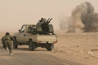 Rebel fighters during heavy shelling by forces loyal to Libyan leader Muammar Gaddafi.