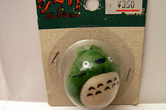 This Totoro toy hangs from your cell phone, just like old Japanese netsukes (net-skay) that would have been carved wood or ivory. LACMA has a huge collection of traditional netsukes. (Credit: John Rabe)