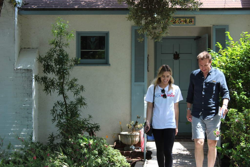 L.A. school board candidate Nick Melvoin, right, walks with campaign volunteer Melissa Lawson while distributing campaign literature and knocking on doors in Mar Vista.