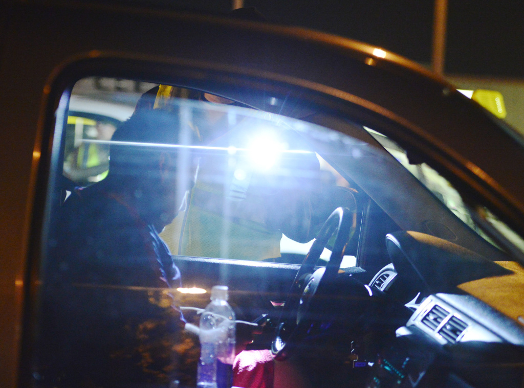 File: A motorist produces their driver's license at a DUI checkpoint in Bellflower on March 6, 2014. The Los Angeles County Sheriff's Department conducted the checkpoint on Alondra Boulevard.