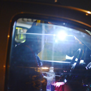 A motorist produces their driver's license at a DUI checkpoint in Bellflower on March 6, 2014.