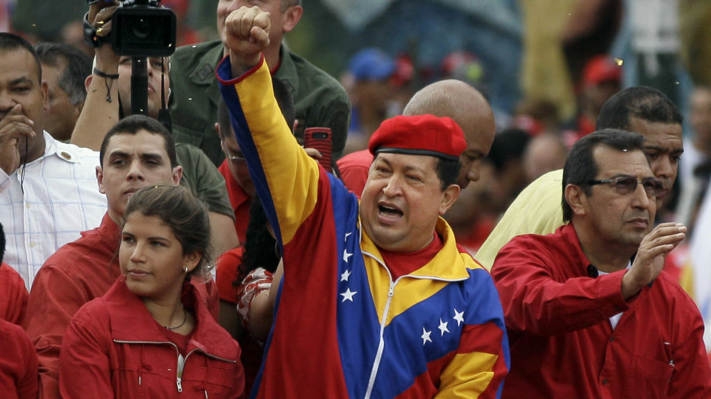Venezuela's President Hugo Chavez arrives atop a truck at the elections office in Caracas on Monday.