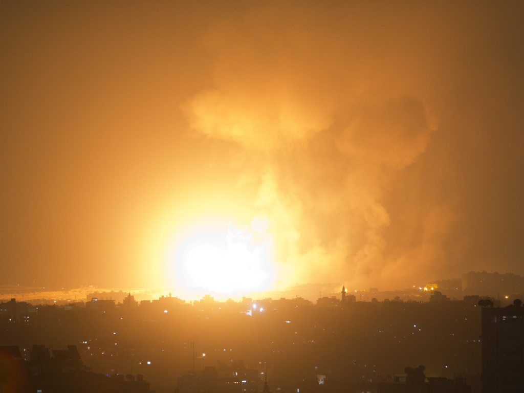 An explosion caused by an Israeli airstrike on Gaza City, early Thursday.