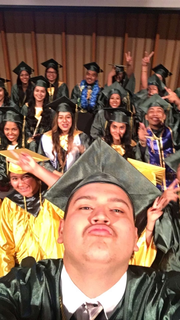 Jeison Reyes pauses for a selfie with his L.A. Leadership Academy high school graduating class of 2016 just before they graduate.