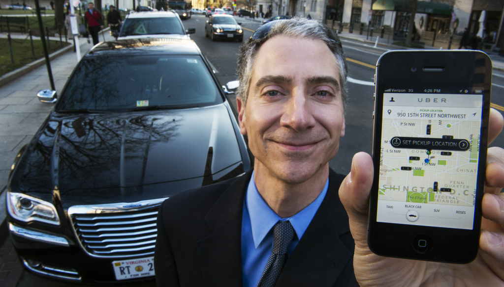 Peter Faris, shown here in Washington, D.C. in February 2013, is an independent driver who works with Uber, a technology firm which has created a mobile app that allows consumers to use their device to request a nearby taxi or limousine. The L.A. Department of Transportation on Monday sent Uber and two similar companies cease-and-desist letters.