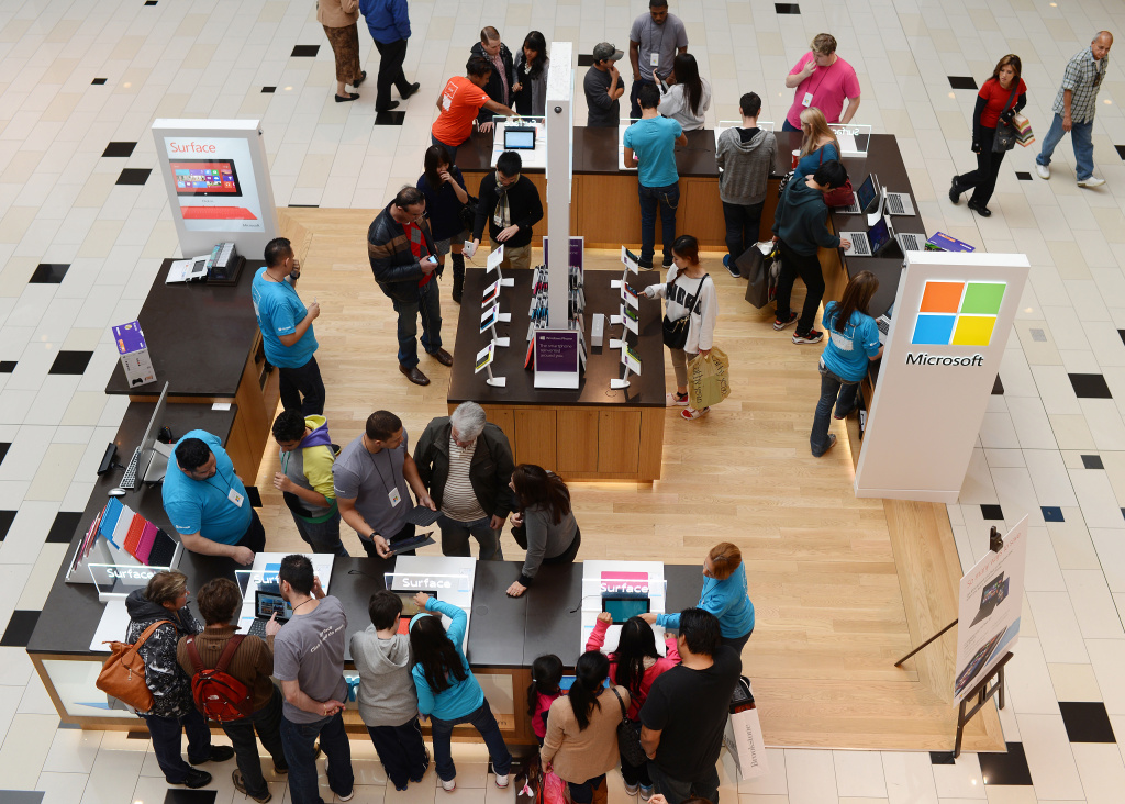 People look at Microsoft Surface tablets at a shopping mall in Glendale, California, approximately 10 miles (16 km) north of Los Angeles, on December 26, 2012. Retail experts predict the day after Christmas will be among the top five shopping days of the year.