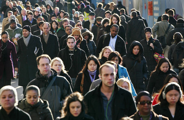 In this Jan. 21, 2010 file photo, a crowd of people walk in New York. The number of people returning their census forms has dropped. The census is the government's once-a-decade population count that will be used to divvy up congressional seats and more than $400 billion in federal aid.