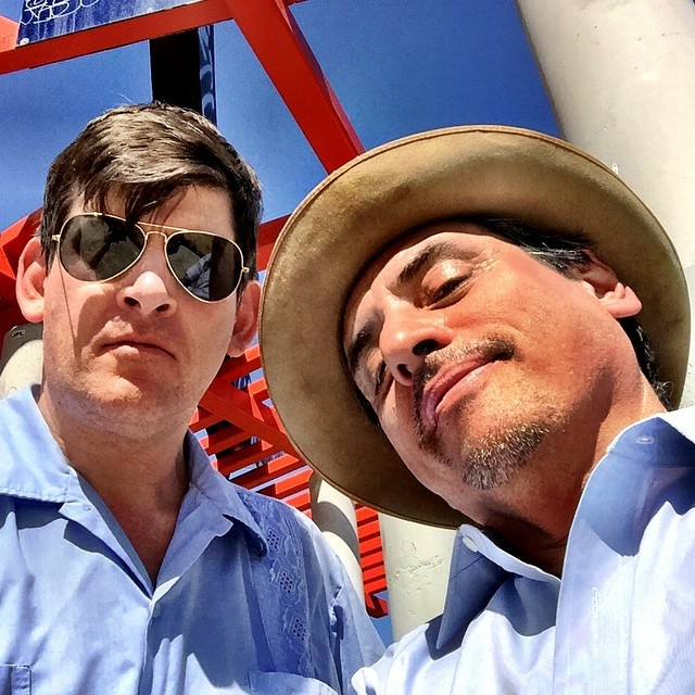 Off-Ramp host John Rabe and Culture Clash's Richard Montoya, at the Frank Glass and Grace E. Simons Memorial Sculpture above Dodger Stadium.