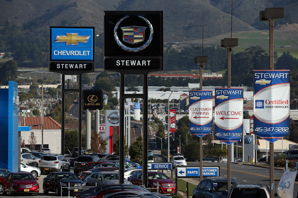The Commerce Department Friday reported that sales at U.S. retailers fell in March from February, indicating that higher taxes and weak hiring may have made some consumers more cautious about spending. (Photo: New cars sit on the sales lot of a Chevrolet dealership in Colma, Calif.)