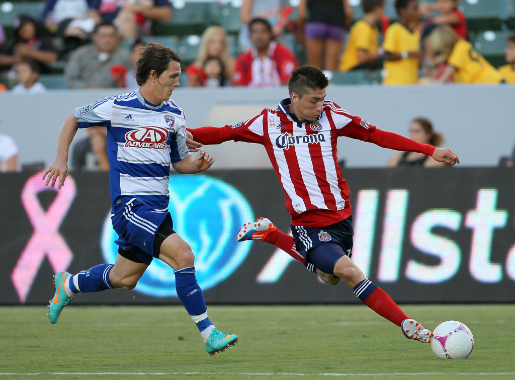 Jorge Villafana #19 of Chivas USA paces the ball on the attack a Zack Loyd #17 of FC Dallas in the second half during the MLS match at The Home Depot Center on October 7, 2012 in Carson, California. FC Dallas and Chivas USA played to a 1-1 draw.