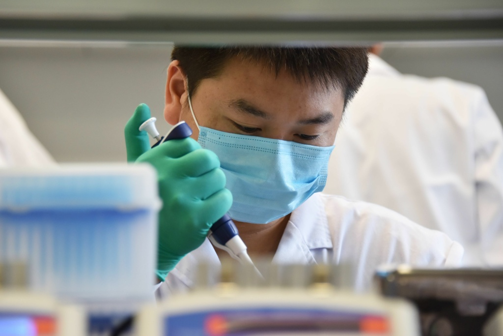 A technician works in a lab at GeseDNA Technology in Beijing. To counter China, the U.S. plans to impose new export restrictions on