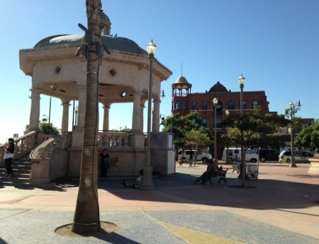 "Mariachi Plaza's ""kiosko,"" with the historic Boyle Hotel in the background. A proposal to develop retail and medical office space at the plaza has drawn controversy."