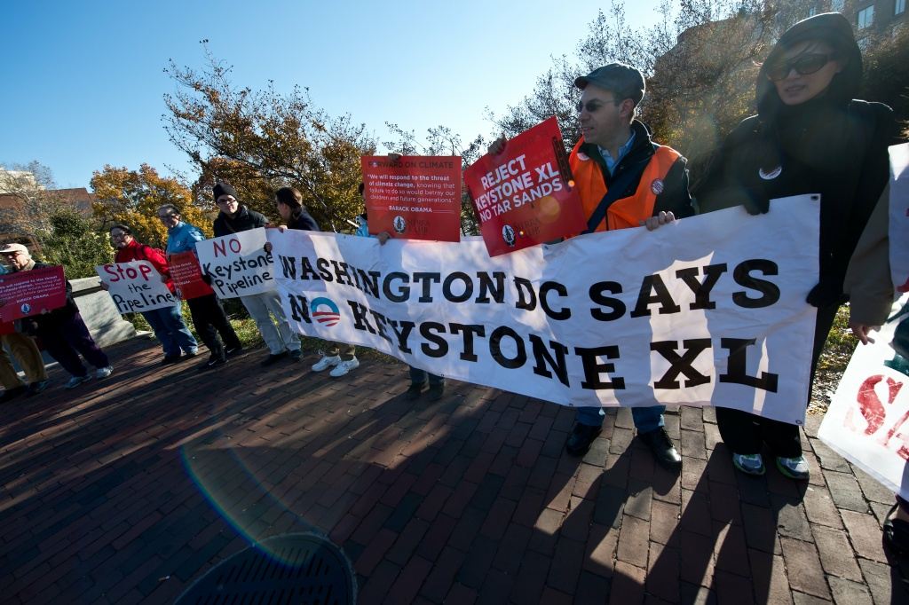 People demonstrate against the proposed Keystone XL pipeline near the hotel where US President Barack Obama is to address the Wall Street Journal CEO Council on November 19, 2013 in Washington.