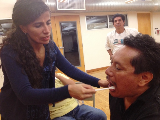 In Los Angeles, Katia Orantes takes a DNA cheek swab from Guatemalan refugee Javier Alvarez. His father was kidnapped during the civil war when he was ten.