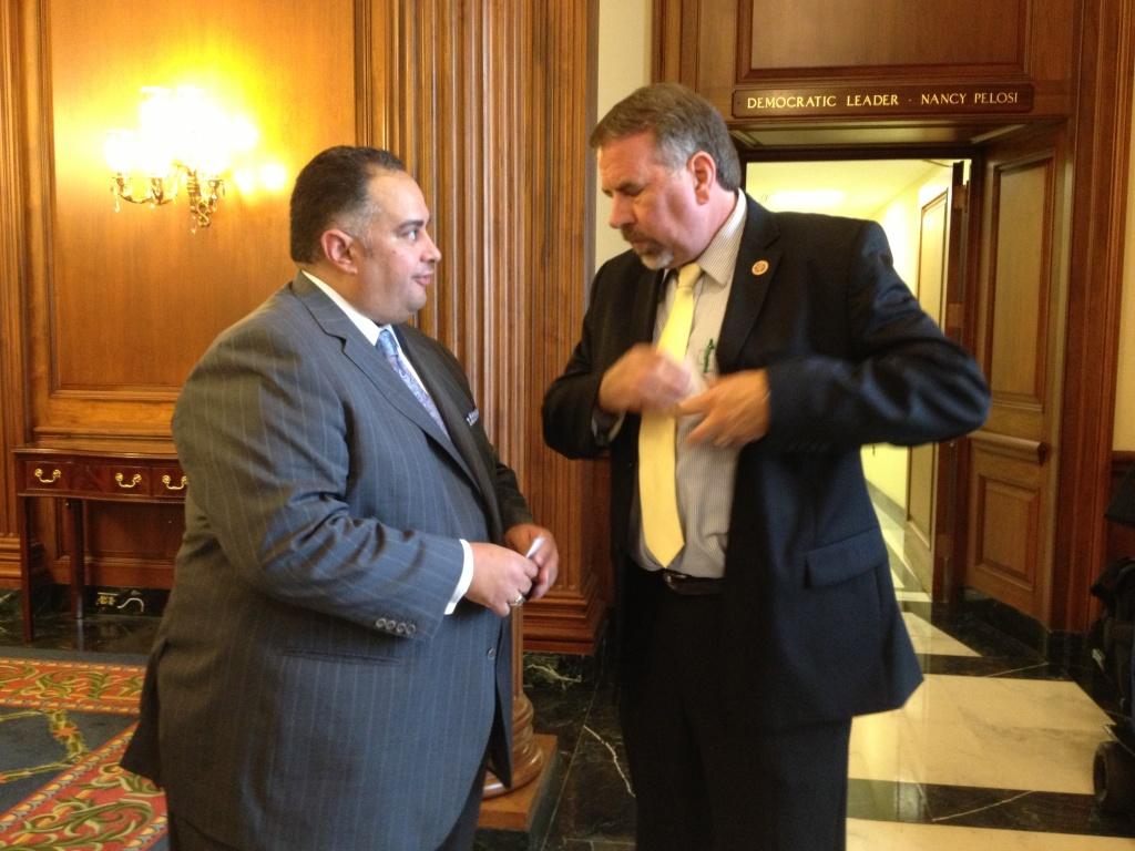 Reunion on Capitol Hill: California Assembly Speaker John Pérez trades business cards with former Sacramento colleague and current GOP Congressman Doug LaMalfa of Redding.