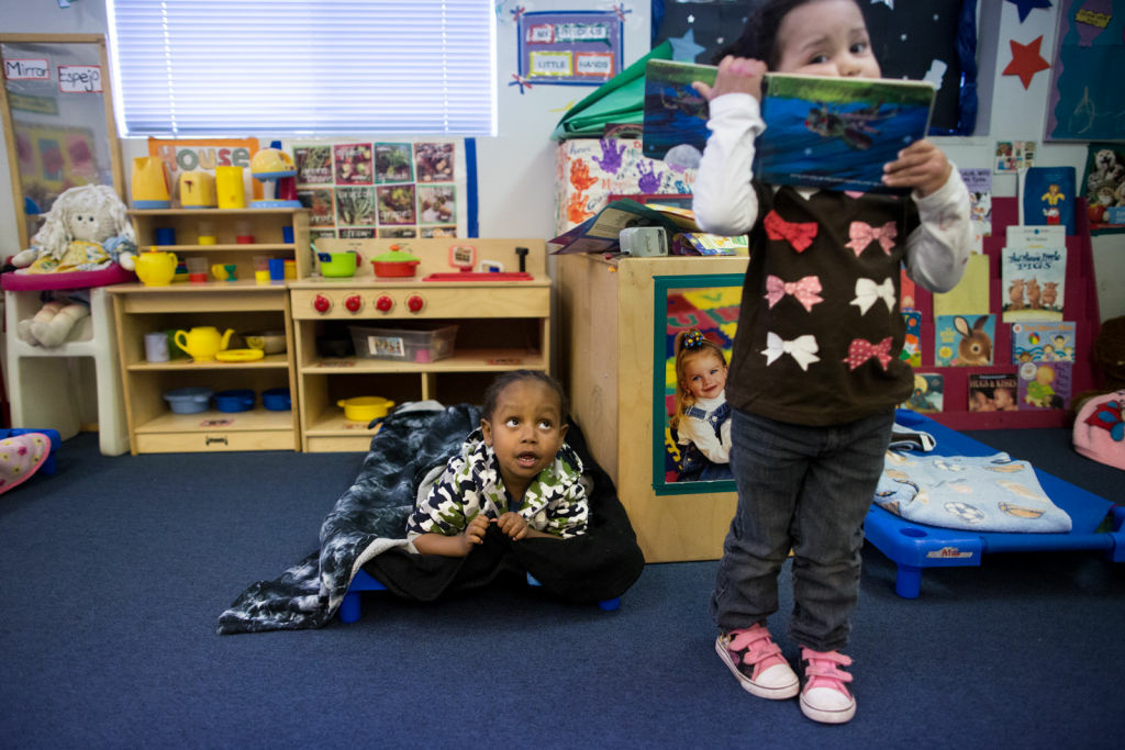 Josiah Robinson, left, and Tiffany Morales play before nap time at Jardín de Niños in Lincoln Heights.