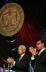 NAACP Chairman Julian Bond (L) and NAACP President Bruce Gordon (R) applaud former U.S. President George W. Bush, after Bush announced support for renewal of the Voting Rights Act in 2006.